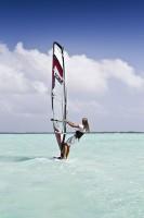 girl windsurfer stock image